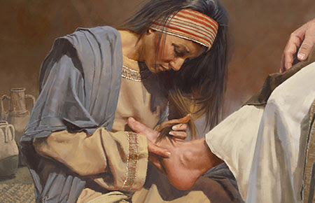 Washing Jesus' feet with her tears